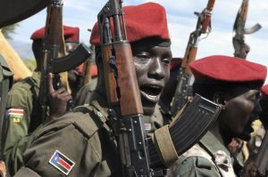 File - In this file photo taken Thursday, April 14, 2016, government soldiers follow orders to raise their guns during a military parade in Juba, South Sudan. Escalating violence in South Sudan is casting a light on Israel's murky involvement in that raging conflict, with the government's use of Israeli arms and surveillance equipment drawing criticism from human rights activists and a lawmaker who are demanding that Israel halt such transfers to the embattled African country. The scrutiny comes as Israel has been forging new ties with countries across Africa, hoping their support will counter Palestinian diplomatic offensives at the United Nations. (Justin Lynch, File/Associated Press)