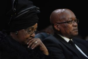 Winnie Madikizela-Mandela (L) and South African President Jacob Zuma (R) attend the funeral of Nelson Mandela in Qunu, South Africa, on December 15, 2013. Madikizela-Mandela has called for introspection and fresh leadership in the ANC. ODD ANDERSEN/AFP/GETTY IMAGES