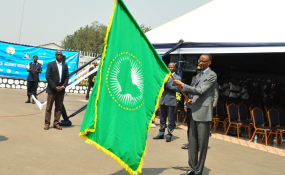 Photo: The New Times President Kagame with African Union flag