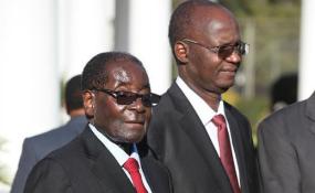 Photo: New Zimbabwe President Robert Mugabe and Higher and Tertiary Education minister Jonathan Moyo.