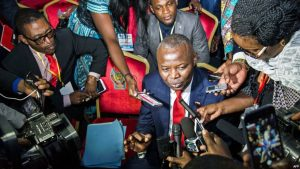 """FILE - Vital Kamerhe, president of the opposition Citizen Front Party (C) speaks to the media during the opening of a Congolese """"National Dialogue"""" in the Democratic Republic of Congo's capital Kinshasa, Sept. 1, 2016."""