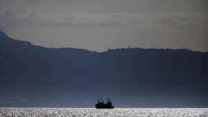 FILE - Chinese fishing trawlers anchor off the coast of Freetown, Nov. 18, 2012