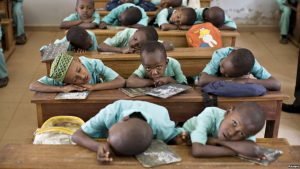 FILE - Muslim boys rest their heads on their desks during a language class at Al-Haramain madrassa at the Islamic Complex in Cameroon's capital Yaounde. Teachers, especially in the north, are afraid to return to their classrooms because of Boko Haram