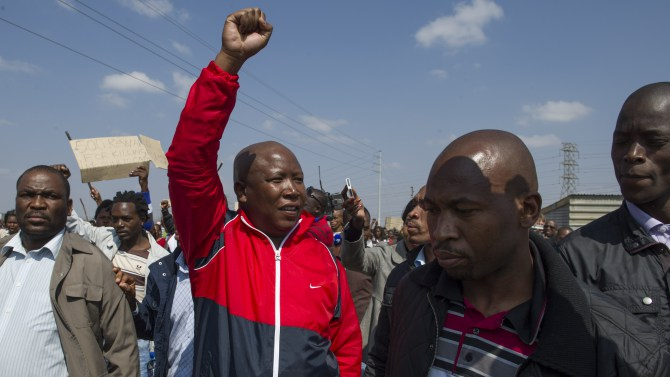 Wonderkop, Marikana, North West Province. August 18, 2012. One of the leaders of the striking Lonmin miners collap[ses after an impassioned narration of the events that saw several of his fellow leaders killed. The community had gathered to have a meeting to discuss the deaths of some 34 of their colleagues two days previously. They were addressed by strike leaders and the expelled African National Congress youth league leader Julius Malema. Malema attacked President Zuma and asked for his revoval, as well as that of police minister Nathi Mtetwa. Photo Greg Marinovich.