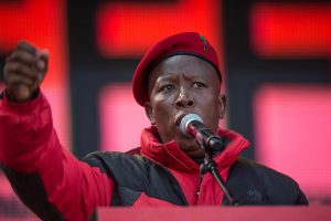 Julius Malema, leader of the Economic Freedom Fighters, speaks at a party rally, Polokwane, South Africa, July 31. Malema's party has launched a criminal case against the Gupta family. MUJAHID SAFODIEN/AFP/GETTY IMAGES