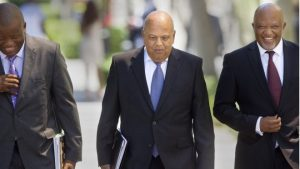 The efforts of Pravin Gordhan (C) to rein in government spending have won him respect