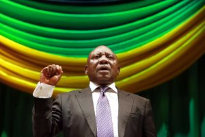 Cyril Ramaphosa, South Africa's deputy president, sings the national anthem at a debate on Nelson Mandela's legacy in Durban, July 16, 2014. Ramaphosa has won the backing of South Africa's biggest trade union group for the ANC leadership. RAJESH JANTILAL/AFP/GETTY