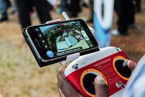 A photo taken on July 24, 2014 shows an aerial view displayed on a mobile phone synchronised to a tele-guided drone camera during an international trade fair in Kigali.  Rwanda is  planning to construct a droneport in order to get drones to carry mostly medical urgent supplies from a central hub to rural areas around the country. / AFP / CYRIL NDEGEYA        (Photo credit should read CYRIL NDEGEYA/AFP/Getty Images)
