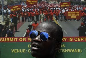 A member of the Economic Freedom Fighters holds a placard during an antigovernment march in Pretoria, South Africa. (Themba Hadebe/Associated Press)
