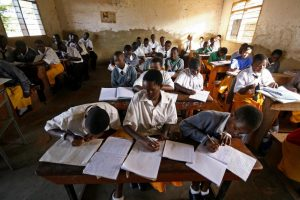 Students at a secondary school in Kampala, Uganda, study during the first lesson of the day on March 23, 2007. Uganda's education sector suffers from dropout rates and teacher absenteeism.
