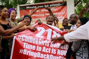 "Members of the #BringBackOurGirls (#BBOG) campaign react on the presentation of a banner which shows ""218"", instead of the previous ""219"", referring to kidnapped Chibok school girls, during a sit-out in Abuja, Nigeria May 18, 2016, after receiving news that a Nigerian teenager kidnapped by Boko Haram from her school in Chibok more than two years ago has been rescued. REUTERS/Afolabi Sotunde"