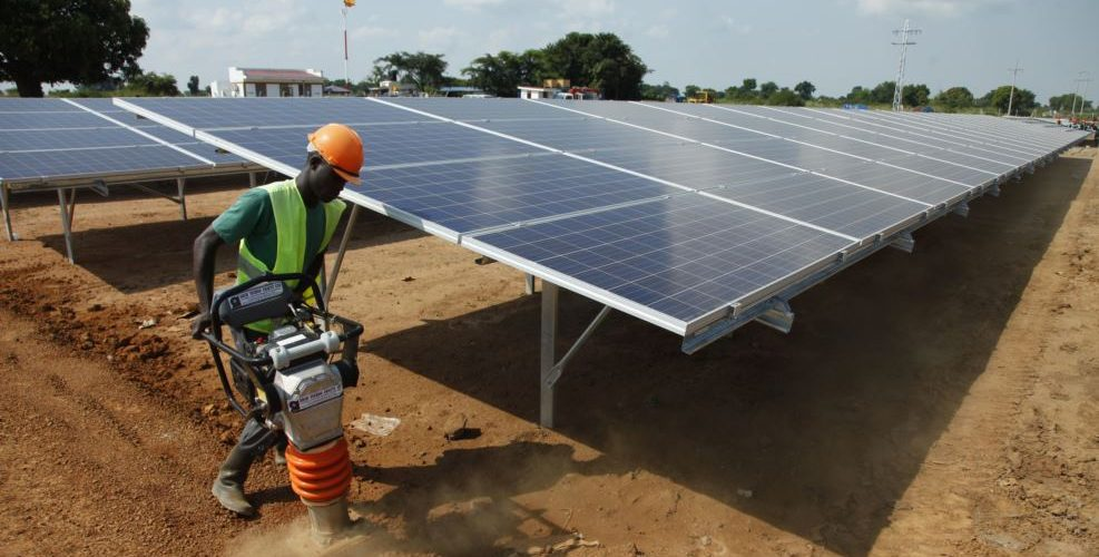 FILE - In this photo taken June 30, 2016, a Ugandan worker levels the ground at a solar plant in Soroti about 300 kilometers east of Uganda capital Kampala.