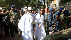FILE - Gambian President Yahya Jammeh arrives at a polling station with his wife Zineb during the presidential election in Banjul, Gambia, Dec. 1, 2016.