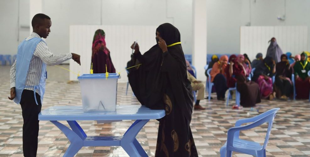 FILE - A woman casts her vote during Somalia's parliament election, at a polling station in Mogadishu, Somalia, Dec. 6, 2016.