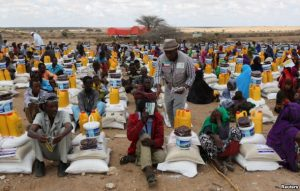 Internally displaced people receive assistance from African Muslim Agency near Adbuqadir town of Awdal region, Somaliland, April 11, 2016. Across the Horn of Africa, millions have been hit by the severe El Nino-related drought.