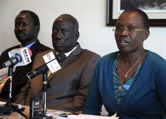 (R-L) Angeline Teny, wife of South Sudan's rebel leader Riek Machar, speaks beside General Alfred Lado Gore and Brigadier General Lul Ruai Koang, military spokesman for Sudan's People Liberation Movement (SPLM) rebel, during a news conference in Ethiopia's capital of Addis Ababa February 26, 2014. REUTERS/Tiksa Negeri