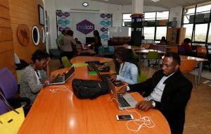 Entrepreneurs work on their projects at Nailab, a Kenyan firm that supports technology startups and seeks their ideas on providing sex education through technology and social media in Nairobi, Kenya, on July 4. A combination of government policy and private sector innovation has seen Kenya become a key technology hub in Africa. THOMAS MUKOYA/REUTERS