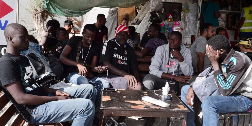 Migrants from Mali sit in a canteen outside the Moria camp on the Greek island of Lesbos, September 20. The EU has signed a deal with Mali to expedite the return of failed asylum seekers from the North African country. LOUISA GOULIAMAKI/AFP/GETTY
