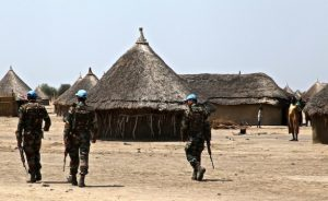 Photo: Jared Ferrie/IPS Peacekeepers patrol a South Sudanese village (file photo).