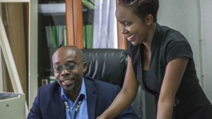 Ndekela Mazimba's (R) boss Justin Mukosa (L) is supportive of the law