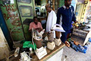 A man waits as a worker repairs an iron at a market in Khartoum, Sudan January 14, 2017. REUTERS/Mohamed Nureldin Abdallah