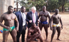 Photo: Marika Tsolakis/Afican Arguments Boris Johnson enjoyed a presentation of traditional Gambian wrestling on his first visit to the continent. This was also the first time a UK Foreign Secretary visited The Gambia.