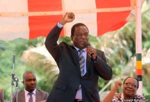 FILE - In this image taken Feb, 10, 2016, Zimbabwean Deputy President Emmerson Mnangagwa greets party supporters at the ZANU-PF headquarters in Harare.