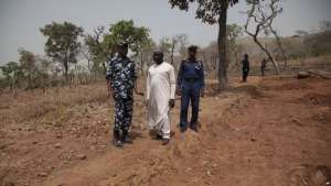Security officers stand guards at the excavation site where German archaeologists were abducted in Janjala Village, Nigeria. Friday, Feb. 24, 2017. Kidnappers are demanding a ransom of 60 million naira (about $200,000) for a German archaeologist and his associate abducted this week from a northern Nigerian village, a worker at the excavation site said. Two villagers were shot and killed in the kidnapping, police confirmed Friday. (AP Photo/Lekan Oyekanmi )