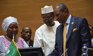 President Idriss Déby of Chad, centre, hands over to President Alpha Condé of Guinea, right, with the former head of the AU, Nkosazana Dlamini-Zuma, left, at the summit in Addis Ababa, Ethiopia. Photograph: Courtesy Africa Union