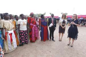 """Dr. Belen Garijo, CEO, Merck Healthcare encouraging infertile women who have been empowered through """"Merck More than a Mother's' 'Empowering Berna' Project in Tororo, Uganda as Rasha Kelej, Chief Social Officer, Merck Healthcare (second left) and Hon. Sarah Opendi, Minister State for Health, Uganda look on"""