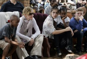 Madonna with her children (L to R) David Banda, Lourdes, Mercy James, and Rocco on a charity visit to Malawi