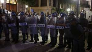 Police dispersed rival groups who fought outside parliament