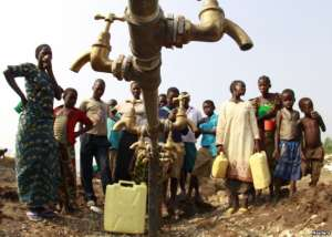 FILE - Congolese refugees, displaced by fighting between the Congo army and rebel group Allied Democratic Forces (ADF), gather around dry water taps at a transit camp southwest of Kampala, July 17, 2013.