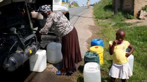 Residents of Ntuzuma collect water from a truck after cuts in water supply were made due to persistent drought conditions, in Durban, South Africa, Jan. 22, 2017.