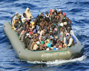 Migration: A boat with African migrants spotted by the Navy at sea near Lampedusa, Italy.Source Daily Mail