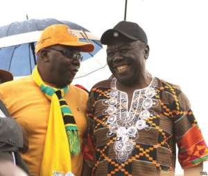 Former Prime Minister Morgan Tsvangirai shares a joke with his former finance minister, Tendai Biti, at a rally of about 500 people in Harare, March 22, 2017. Tsvangirai said the next election is heading for a dispute unless the Zimbabwe Electoral Commission steps aside. (S. Mhofu/VOA)