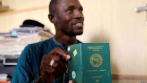 FILE - Abdul Giwa holds a copy of his passport during an interview with Reuters on the recent pronouncements of the Kaduna State government on the activity of the Shi'ite group in Kaduna, Nigeria Nov. 2, 2016. Nigeria has advised its citizens against any non-urgent travel to the United States until Washington clarifies its immigration policy