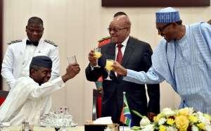 Acting President Yemi Osinbajo (left) toasts with President Muhammadu Buhari (right). Credit: GCIS.