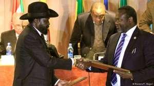 South Sudan President Salva Kiir and rebel leader Riek Machar shake hands.