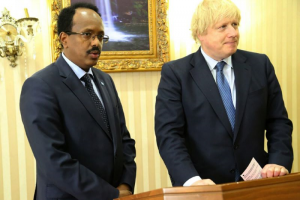 This handout photograph taken and released by the Office of the Somali President on March 15, 2017 shows British Foreign Minister Boris Johnson (R) standing next to Somali President Mohamed Abdullahi Mohamed in Mogadishu (AFP Photo/HO)