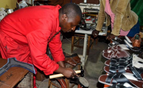 Photo: The New Times A man makes leather products in his workshop in Kigali (file photo).