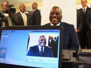 SMILE FOR THE CAMERA: President Joseph Kabila of the Democratic Republic of Congo at the launch of the country's new biometric passport in Kinshasa in November 2015. Kabila remains in office despite protests that new presidential elections are overdue. RTNC/Handout via Reuters TV
