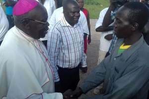 Gulu Archbishop John Baptist Odama (left) welcomes Mr Michael Omona, a former LRA signaller, upon arrival at Gulu Airfield on Monday. PHOTO BY JULUIS OCUNGI