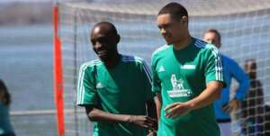 Joseph Opio left, and Trevor Noah at a game of football in New York.