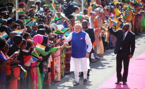 Photo: Mohamed Mambo/Daily News Indian Prime Minister Narendra Modi and his host, President John Magufuli, acknowledge cheers from a section of Dar es Salaam residents who turned up at the State House grounds in the city.