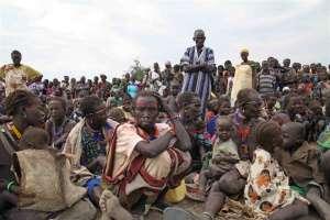 A crowd awaits food distribution at Pibor town, South Sudan. Photo: IRIN/Hannah McNeish ?