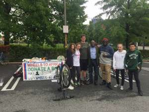 Support for a noble cause:Ambassador Arouna with Jason and his young friends collecting bikes to send to Africa