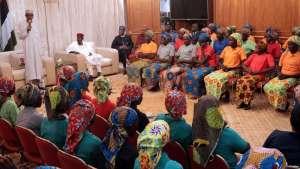 Nigerian President Muhammadu Buhari (left) addresses 82 freed Chibok schoolgirls during a meeting with them in Abuja, Nigeria, May 7, 2017. (Source - @MBuhari)