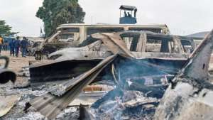 Cars parked at the front of the prison were burnt during the jail-break