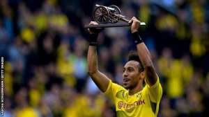 Pierre-Emerick Aubameyang lifts the trophy as the Bundesliga's top-scorer with 31 goals